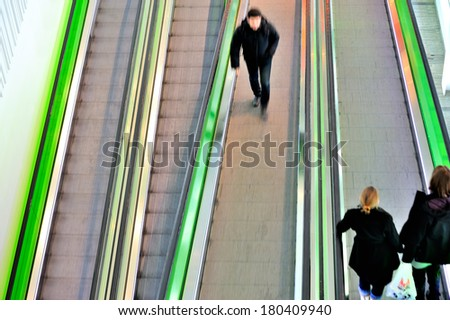 Moving escalator seen from above - stock photo