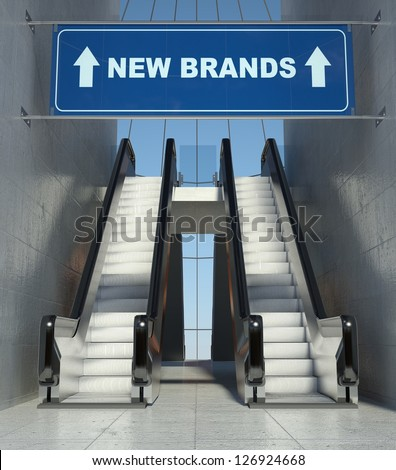 Moving escalator stairs in modern mall, new brands sign - stock photo