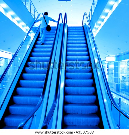 Moving escalator with person in airport
