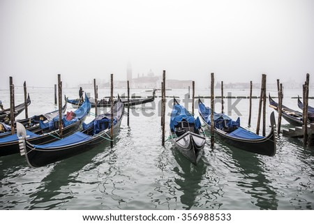 Moving Gondolas in front of San Marco square, Venice Italy