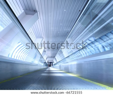 moving horizontal escalator in the public transit