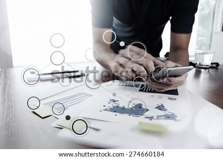 Moving Image of Business creative designer working with smart phone and tablet computer  blank flow chart at office as concept - stock photo