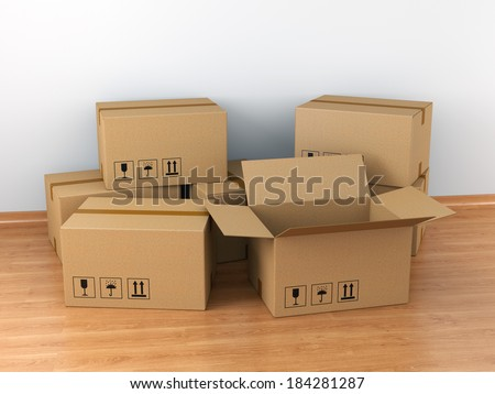 Moving in concept: group of cardboard boxes in empty room