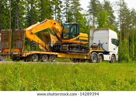 moving in some construction machinery - stock photo
