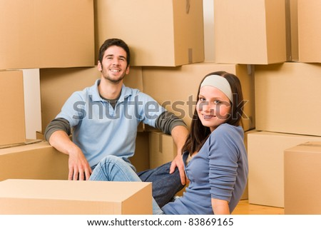 Moving into new home young happy couple sitting on floor