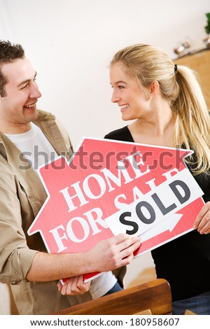 Moving: Man Puts Sold On Home Sale Sign
