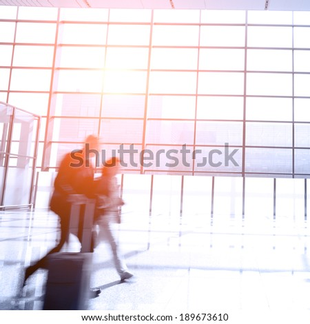 moving people at modern airport - stock photo