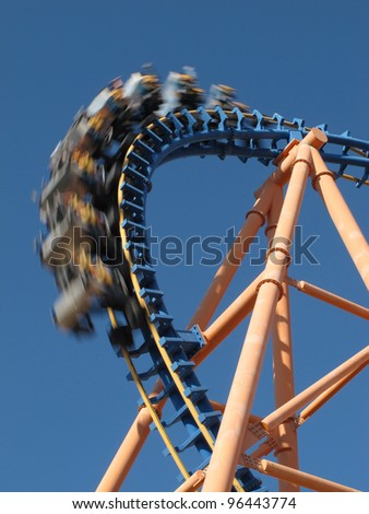 moving roller coaster with blue sky - stock photo