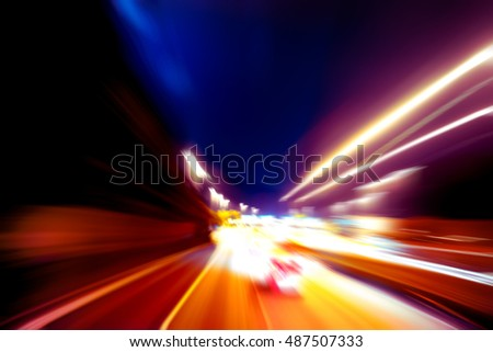 moving traffic light trails at night