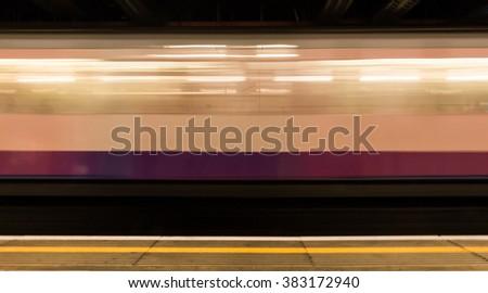 Moving train in Embankment subway station. London, UK. - stock photo