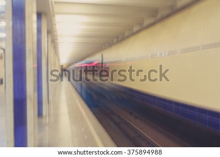 Moving train in subway tunnel. Abstract blur - stock photo