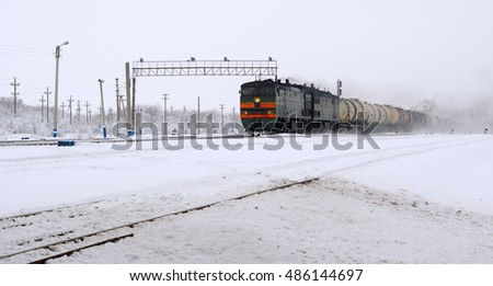 Moving train with tank cars in winter