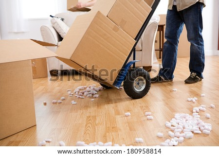 Moving: Using A Handcart to Move Boxes - stock photo