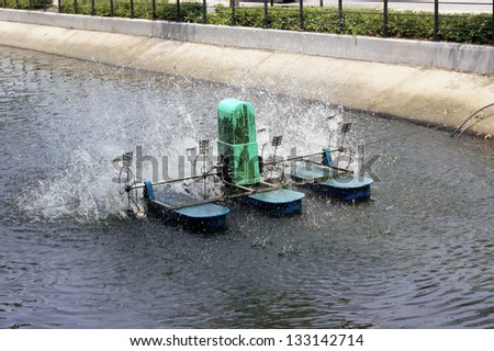moving water turbine - stock photo