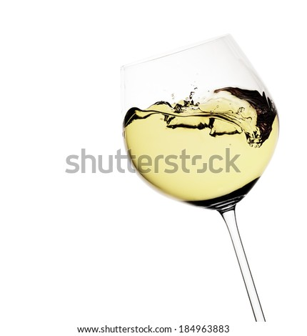 Moving white wine glass over a white background