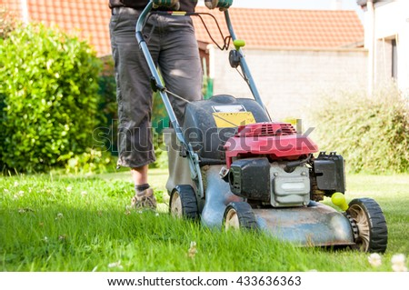 mowing the lawn in a garden