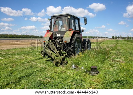 mowing the succulent grasses to feed cattle in a mechanized way - stock photo