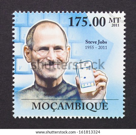 MOZAMBIQUE - CIRCA 2011: A postage stamp printed in Mozambique showing an image of Steve Jobs with an iPhone, circa 2011.  - stock photo