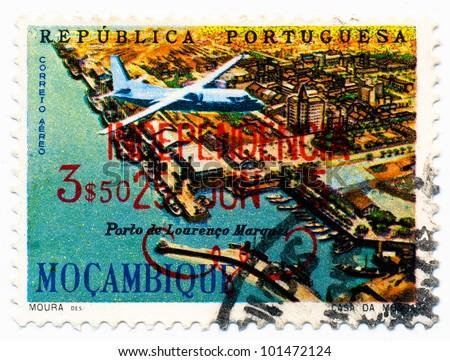 MOZAMBIQUE - CIRCA 1962: A stamp printed in Mozambique, shows a Lourenco Marques harbor, circa 1962 - stock photo