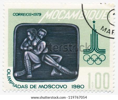 MOZAMBIQUE - CIRCA 1979: A stamp printed in Mozambique, shows wrestling, circa 1979 - stock photo