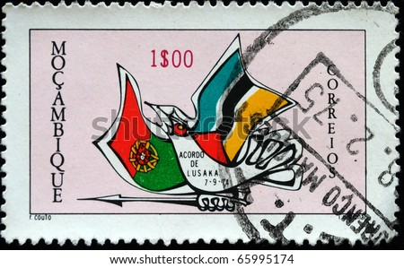 MOZAMBIQUE - CIRCA 1974: Stamp printed in Mozambique Dedicated to Agreement dated September 7, 1974, in Lusaka (Zambia), between Portuguese government and Liberation Front of Mozambique, circa 1974 - stock photo