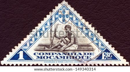 MOZAMBIQUE COMPANY- CIRCA 1935: A stamp printed in Mozambique shows man in canoe, circa 1935.  - stock photo