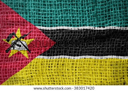 Mozambique flag on sackcloth textured background