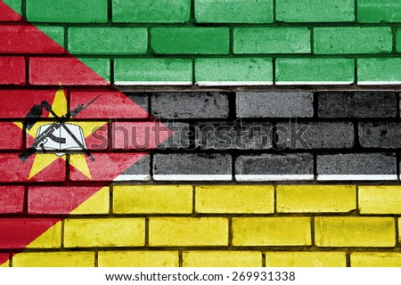 Mozambique flag painted on old brick wall texture background - stock photo