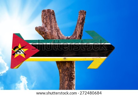 Mozambique Flag wooden sign with sky background - stock photo