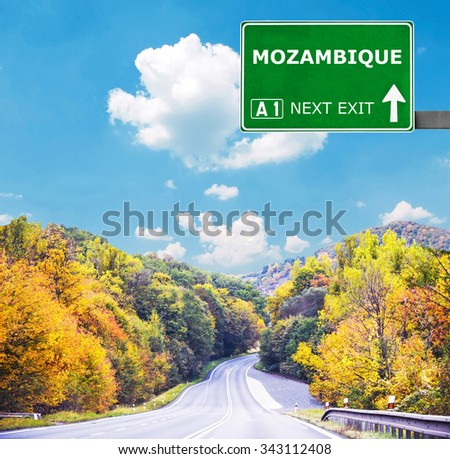 MOZAMBIQUE road sign against clear blue sky - stock photo