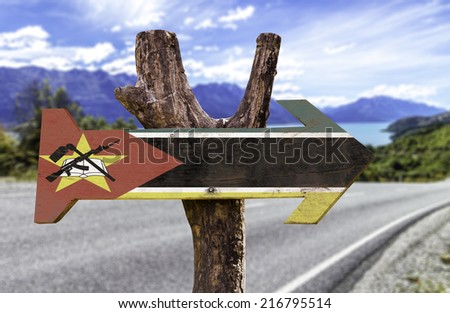 Mozambique sign with a landscape3 on background - stock photo