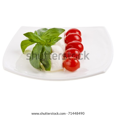 Mozzarella, basil and tomatoes in plate  isolated on white background - stock photo