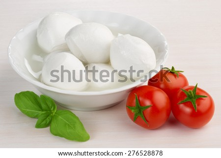 mozzarella cheese, cherry tomatoes and basil leaf - stock photo