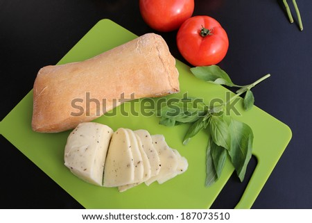 mozzarella cheese, tomatoes and basil prepared for cooking panini sandwich