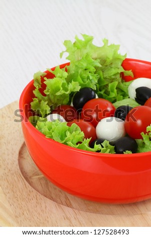 Mozzarella, cherry tomatoes and olives salad
