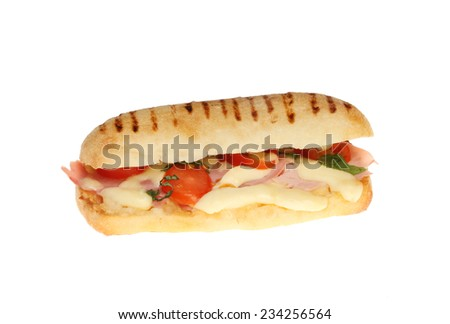 Mozzarella, ham, tomato and basil pannini isolated against white - stock photo