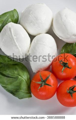 Mozzarella Tomatoes and Basil typical italian food ingredients  - stock photo