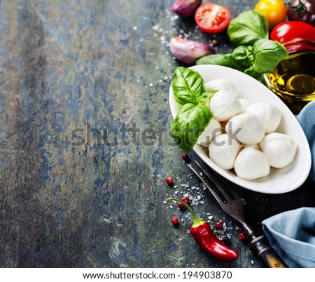 Mozzarella with tomatoes and basil leaves  on Wooden background - stock photo
