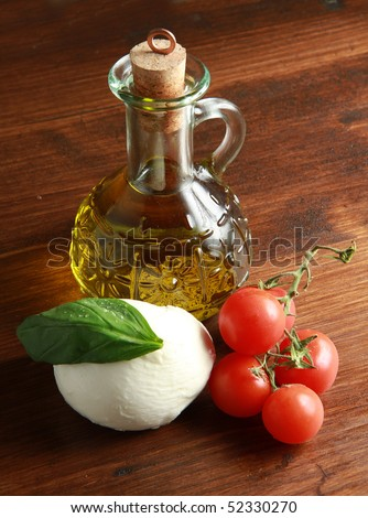 mozzarella with tomatoes, oil and basil - stock photo