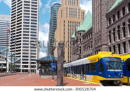 MPLS, MN/USA - JUNE 28, 2015: Central business district of Minneapolis. Together, the twin cities of Minneapolis and St. Paul anchor the second largest economic center in the Midwest behind Chicago.  - stock photo