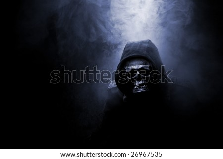 Mr death in jacket in smoke - stock photo
