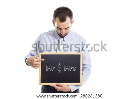 Mr & Mrs  - Young businessman with blackboard - isolated on white - stock photo