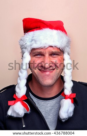 Mr. Santa Claus gives a knowing wink. Grin spitefully Mr. Santa Claus - stock photo