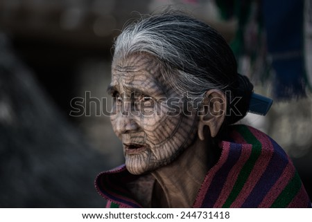 MRAUK-U, MYANMAR - DEC 14, 2014 : The portrait of Chin woman with spider tattoo - stock photo