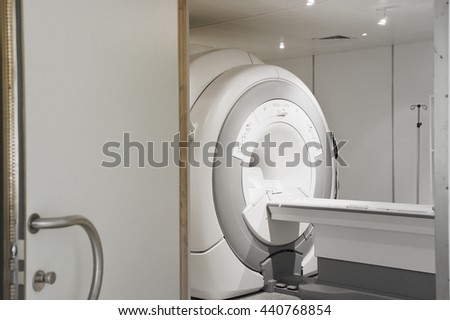 MRI scanner room in hospital take with selective color technique and art lighting