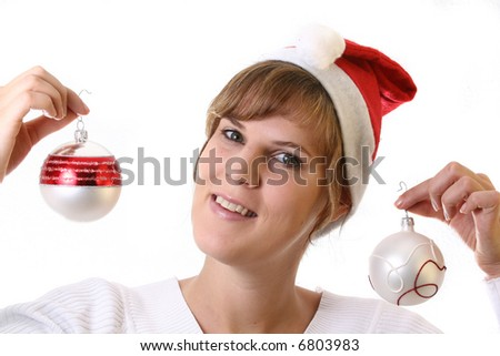 Mrs. Santa Is Preparing A young beautiful cute and happy Christmas woman is smiling. Isolated over white with a Christmas glitter balls.