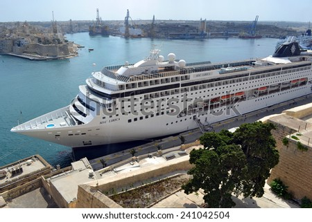 MSC Lirica cruise ship At Port of Valletta, Malta - September 24, 2014: is docked in port of Valetta, is waiting for the passengers who's having promenade in the capital of Malta - Valetta, to board. - stock photo