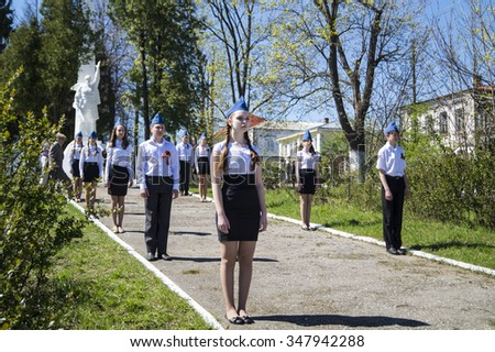 Mstera,Russia-May 9,2015: Teenager carry guard beside monument soldier at Day of the Victory May 9,2015 in Mstere,Russia