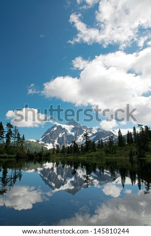 Mt Baker, a beatiful reflection on the picture lake. - stock photo