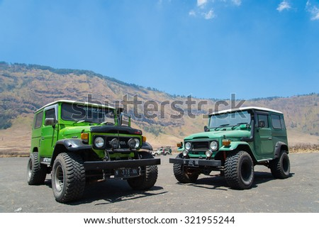 Mt.Bromo's Savannah, Indonesia ,13 Sep. 2016 : 4x4 Unidentified Jeep parking at Savannah grassland in summer.